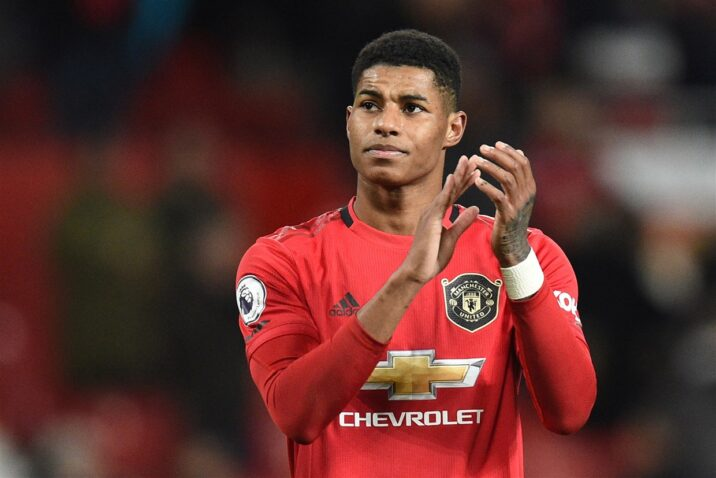 Marcus Rashford MBE claps on the pitch