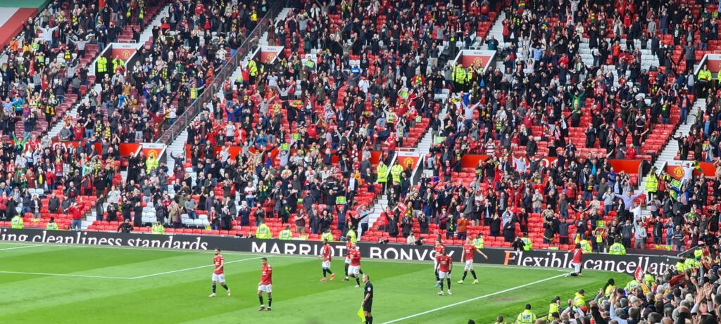 United fans celebrating Edinson Cavani's sublime goal against Fulham at Old Trafford on Tuesday evening that ended in a 1-1 draw